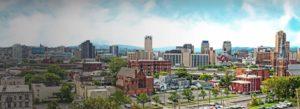 Header-Syracuse-Skyline-light-clouds